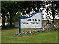 TG2115 : Abbey Farm Commercial Park sign by Adrian Cable