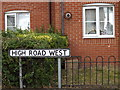TM2935 : High Road West sign by Adrian Cable