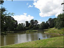 SJ6855 : Queen's Park: lake, west end by Stephen Craven