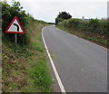SS0198 : Bend in the road sign near Freshwater East  by Jaggery