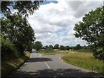 TM1469 : B1077 Eye Road, Thorndon by Geographer