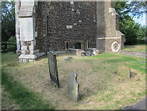 TQ3089 : Gravestones at the foot of St. Mary's Tower, Hornsey by Mike Quinn