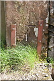 NY6319 : Benchmark on cattlegrid gatepost at track to Crabstack by Roger Templeman