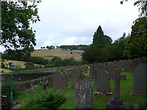 SK2381 : St Michael, Hathersage: churchyard (i) by Basher Eyre