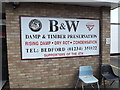TL0652 : B & W Damp & Preservation sign by Geographer
