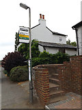 TL1614 : Folly Fields Bus Stop sign by Adrian Cable