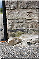 NY6319 : Benchmark on house at Chitty Hill by Roger Templeman