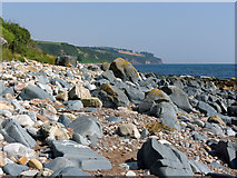 NH7763 : Beach of boulders south of Eathie by Julian Paren