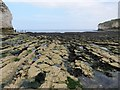 TA2570 : Rock  scars  cover  Selwicks  Bay  at  low  water by Martin Dawes
