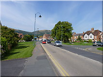 SO7845 : Barnard's Green Road with Malvern Hills behind by Jeff Gogarty