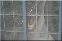 TQ3083 : View of a Eurostar train at the platform at St. Pancras station from the second floor staircase by Robert Lamb