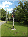 TM1168 : Thwaite Village sign by Adrian Cable