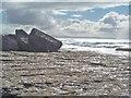 L9500 : Boulders on the shore by Gordon Hatton
