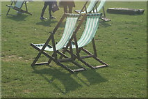 TQ2780 : View of deckchairs in the sun in Hyde Park by Robert Lamb