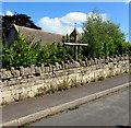 SO8602 : Wooden cross at a churchyard perimeter wall, Brimscombe by Jaggery