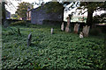 NY7441 : Overgrow graveyard at St John's Church, Garrigill by Ian S