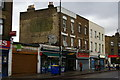 TQ3576 : Shops and ghost-sign, Queens Road, Peckham by Christopher Hilton