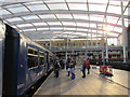 SJ8499 : Manchester Victoria station: waiting to board by Stephen Craven