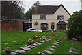 SP0279 : St Laurence Churchyard and Great Stone Inn, Northfield by Stephen McKay