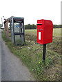 TM0214 : Blue Row Postbox, Telephone Box & Bus Shelter by Adrian Cable