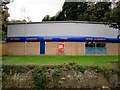 SO8405 : Kwik Fit riverbank side, Stroud by Jaggery