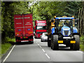 TL8571 : Tractor on the A134 near Ampton by David Dixon