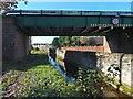 NS4074 : Gruggies Burn flowing under railway bridge by Lairich Rig