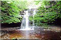 NY9028 : Gibson Cave Summerhill Waterfall by John Ryles