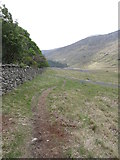 J3431 : Path descending towards Newcastle alongside the Tollymore Forest Park wall by Eric Jones