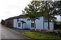 NY6528 : Houses at Gullom Holme near Milburn by Ian S