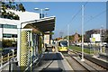 SJ8387 : Benchill tram stop by Alan Murray-Rust