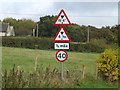 TM3861 : Roadsigns on the B1121 Main Road by Adrian Cable