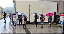 SK3281 : Queuing in the rain by Chris Morgan