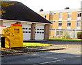 SJ2207 : Yellow donations bin outside Welshpool Fire Station by Jaggery