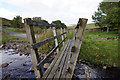 NY7638 : Footbridge over Clargill Burn by Ian S