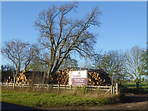 NZ1085 : Firewood business on the Meldon Park estate by Oliver Dixon