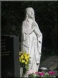 TQ2886 : Praying by the grave by Bill Nicholls