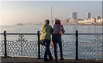 TQ3103 : Two People Admiring the View from Brighton Pier, Brighton, East Sussex by Christine Matthews