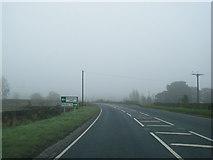 SE7485 : A170 nearing Sinnington turn by Colin Pyle