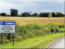 TG2815 : Crop Harvest between Wroxham and Rackheath by David Dixon