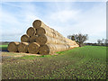 NZ2424 : Straw bales along field edge by Trevor Littlewood