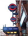 TQ2578 : London Underground roundels, Earl's Court by Julian Osley