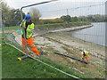 SP9114 : Repairing Startops Reservoir (2) Erecting Fencing by Chris Reynolds