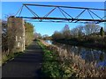 NS6674 : Pipe bridge over the Forth & Clyde Canal near Harestanes by Gordon Brown