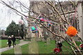SP9211 : A Decorated Tree in Tring Churchyard by Chris Reynolds