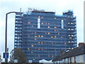 TQ2564 : Tower block under renovation on Chaucer Road by David Howard