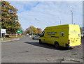 SJ2207 : Yellow van on the B4381, Welshpool by Jaggery