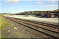 SD7678 : Piles of stone chippings in Ribblehead Quarry by Roger Templeman