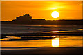 NU1438 : Bamburgh Castle at sunrise by Ian Capper