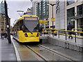 SJ8398 : Metrolink Tram at Exchange Square by David Dixon